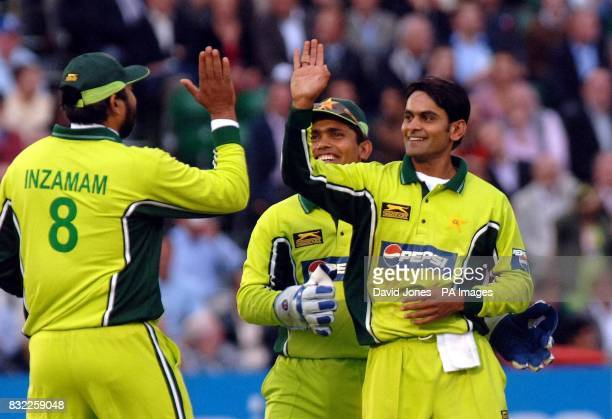 Pakistan's Mohammad Hafeez celebrates with captain InzamamulHaq after taking the wicket of England's Paul Collingwood during the first NatWest Series...