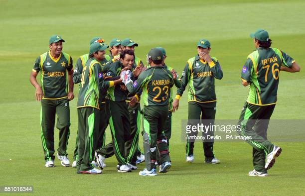 Pakistan's Mohammad Hafeez is congratulated after Kamran Akmal stumped West Indies' Marlon Samuels during the ICC Champions Trophy match at The Oval...