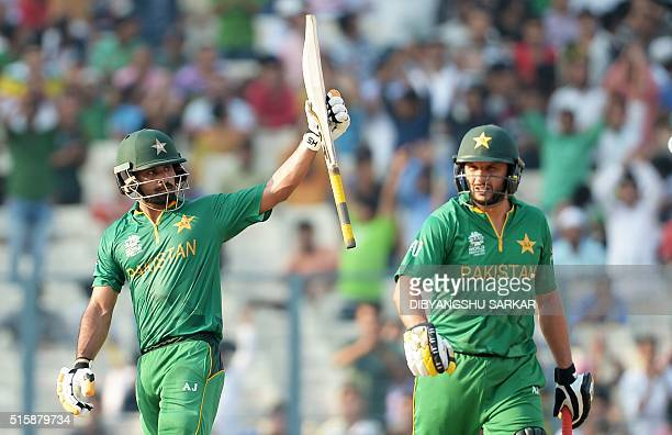 Pakistan's Mohammad Hafeez is watched by captain Shahid Afridi as he celebrates after scoring a halfcentury during the World T20 cricket tournament...