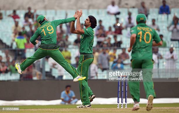 Pakistan's Mohammad Irfan with teammate Ahmed Shehzad celebrates after the dismissal Sri Lanka's Tillakaratne Dilshan during a practice match between...