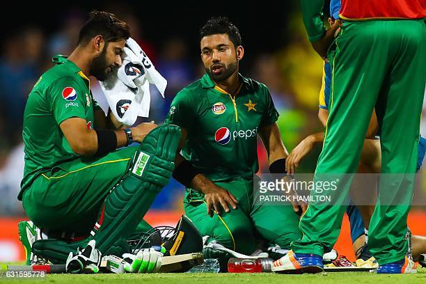 Pakistan's Mohammad Nawaz and Mohammad Rizwan talk during the oneday international cricket match between Pakistan and Australia in Brisbane on...