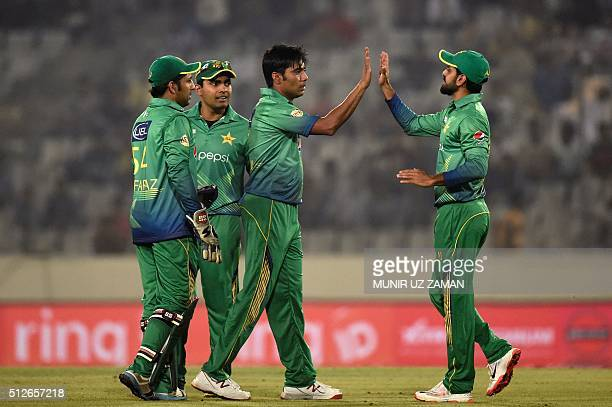 Pakistan's Mohammad Sami celebrates with teammates after the dismissal of India's Virat Kohli during the Asia Cup T20 cricket tournament match...