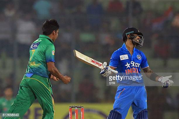 Pakistan's Mohammad Sami reacts after the dismissal of India's Virat Kohli during the Asia Cup T20 cricket tournament match between India and...
