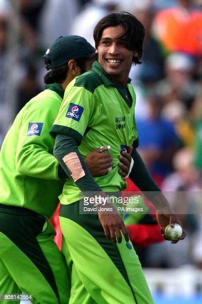 Pakistan's Mohammed Amir celebrates claiming the wicket of Australia's Mitchell Johnson