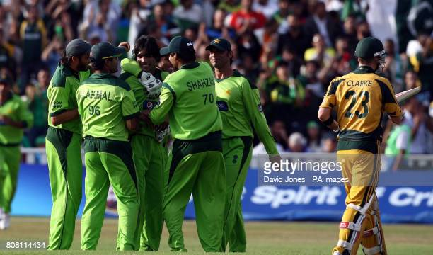 Pakistan's Mohammed Amir claims the wicket of Australia's Michael Clarke for 30 runs during the Second Twenty20 International match at Edgbaston...