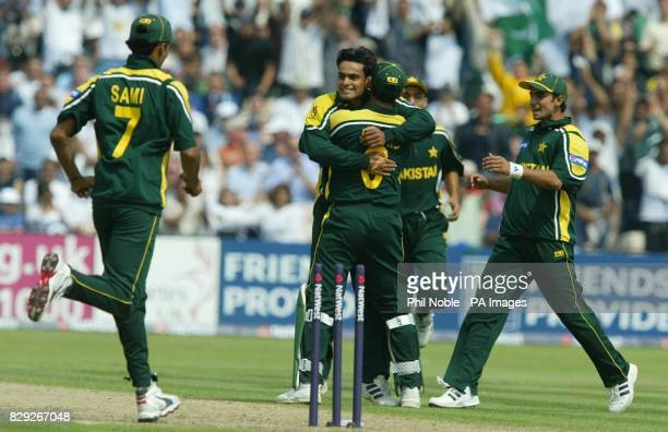 Pakistan's Mohammed Hafeez is congratulated by team mates after dismissing England's Vikram Solanki during the first NatWest challenge match between...