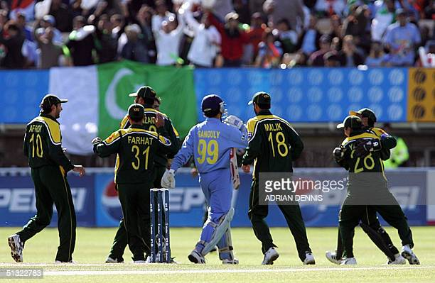 Pakistan's Moin Khan celebrates taking a catch off the bowling of Mohammad Sami to claim India's Captain Sourav Ganguly for the opening wicket in the...