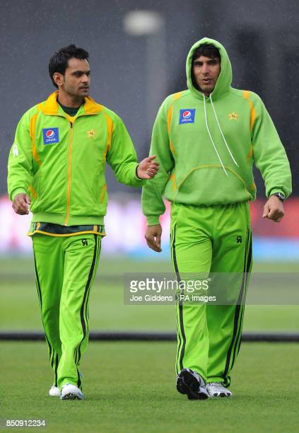 Pakistan's Muhammad Hafeez and captain Misbah ul Haq leave the field as rain falls before the ICC Champions Trophy Warm Up match at Edgbaston...