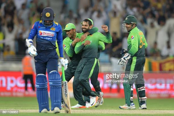 Pakistan's Muhammad Hafeez celebrates after he dismissed Sri Lanka's Upul Tharanga during the first one day international cricket match between Sri...