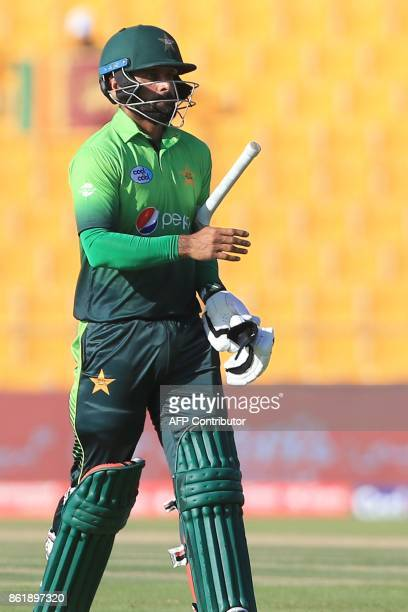 Pakistan's Muhammad Hafeez leaves the field after being dismissed by Sri Lank's Nickwella Dickwella during the second one day international cricket...