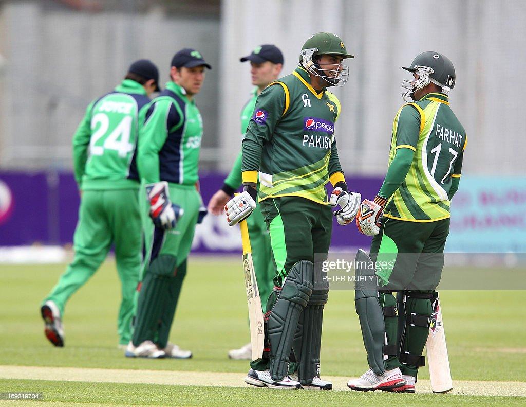 Pakistan's Nasir Jamshaid (L) and Imran Farhat (R) speak before batting during the One Day International (ODI) cricket match between Pakistan and Ireland at Clontarf Cricket Club in Dublin on May 23, 2013.