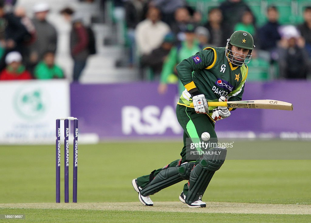 Pakistan's Nasir Jamshaid looks on after playing a shot during the One Day International (ODI) cricket match between Pakistan and Ireland at Clontarf Cricket Club in Dublin on May 23, 2013.