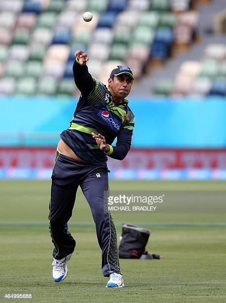 Pakistan's Nasir Jamshed throws the ball during a training session ahead of their 2015 Cricket World Cup Group B match against United Arab Emirates...