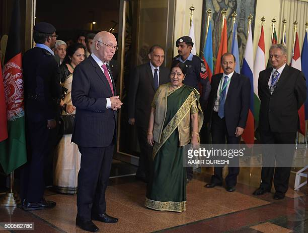 Pakistan's National Security Advisor Sartaj Aziz gestures as he arrives with Indian Foreign Minister Sushma Swaraj at The Foreign Ministry in...