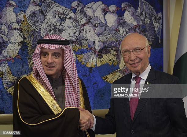 Pakistan's National Security Advisor Sartaj Aziz shakes hands with Saudi Minister of Foreign Affairs Adel alJubeir prior to their meeting at the...