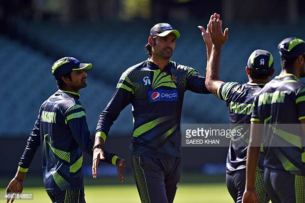 Pakistan's paceman Mohammad Irfan gets ready for the fielding practice in Adelaide on March 19 ahead of Pakistan's 2015 Cricket World Cup...