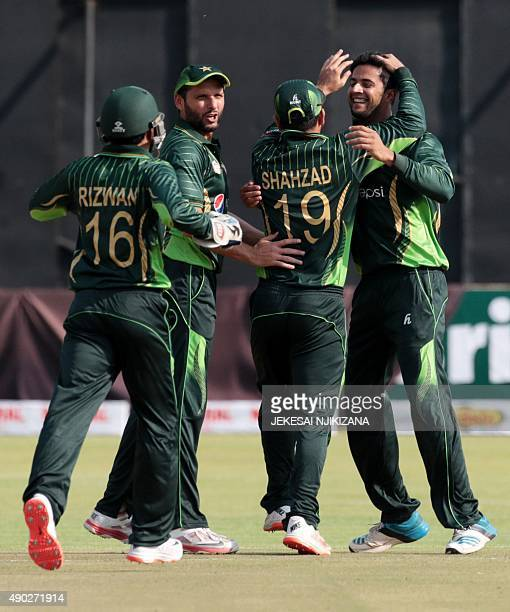 Pakistan's players celebrate a wicket during the first of two T20 cricket matches between Pakistan and hosts Zimbabwe at the Harare Sports Club on...