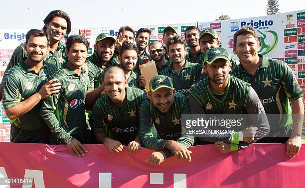 Pakistan's players celebrate with the series trophy after their victory in the final game in a series of three ODI cricket matches between Pakistan...