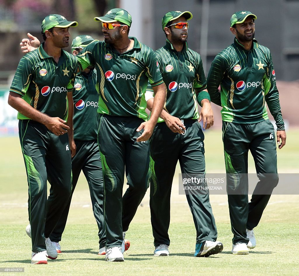 Pakistan's players walk off the pitch after restricting Zimbabwe's innings during the final game of a three ODI cricket matches between Zimbabwe and...
