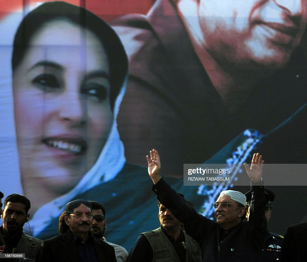 Pakistan's President Asif Ali Zardari (R), widower of assassinated former premier Benazir Bhutto, waves to supporters outside the Bhutto family mausoleum in Garhi Khuda Bakhsh on December 27, 2012, on the fifth anniversary of the assassination of Benazir Bhutto. The son of Pakistan's slain former prime minister Benazir Bhutto launched his political career on the anniversary of his mother's death with an attack on the country's judiciary. More than 200,000 people gathered at the Bhutto family mausoleum in Garhi Khuda Bakhsh in the southern province of Sindh to pay their respects to Benazir and to hear Bilawal Bhutto Zardari make his first major public speech.