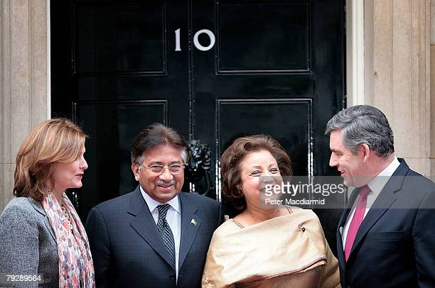 Pakistan's President Pervez Musharraf and his wife Sehba are welcomed in Downing Street by Prime Minister Gordon Brown and his wife Sarah on January...