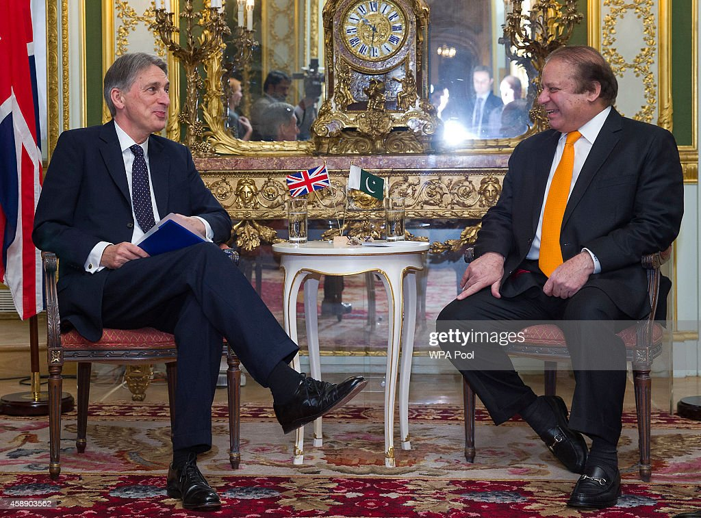 Pakistan's Prime Minister <a gi-track='captionPersonalityLinkClicked' href=/galleries/search?phrase=Nawaz+Sharif&family=editorial&specificpeople=217726 ng-click='$event.stopPropagation()'>Nawaz Sharif</a> (R) meets with British Foreign Secretary <a gi-track='captionPersonalityLinkClicked' href=/galleries/search?phrase=Philip+Hammond&family=editorial&specificpeople=2486715 ng-click='$event.stopPropagation()'>Philip Hammond</a> after the opening session of the UK-Pakistan Energy Dialogue on November 13, 2014 in London, England. They discussed in the meeting how Pakistan can best address its energy challenges by sharing expertise and experience in the energy sector.