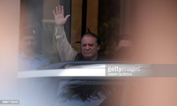 Pakistan's Prime Minister Nawaz Sharif waves as he arrives to appear before an anticorruption commission at the Federal Judicial Academy in Islamabad...