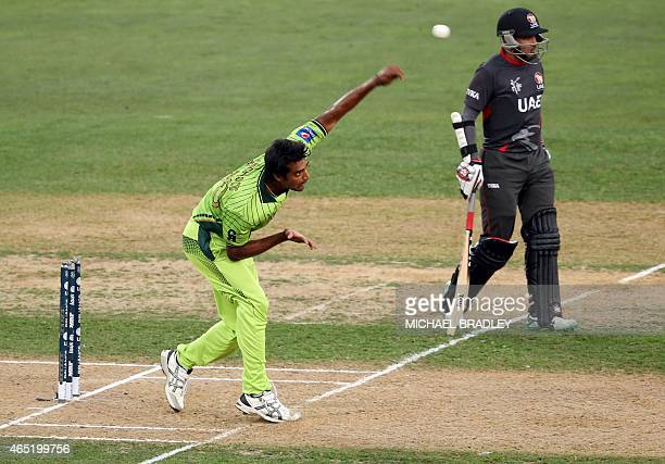 Pakistan's Rahat Ali bowls watched on by UAE's Khurram Khan during the Pool B Cricket World Cup match between the United Arab Emirates and Pakistan...