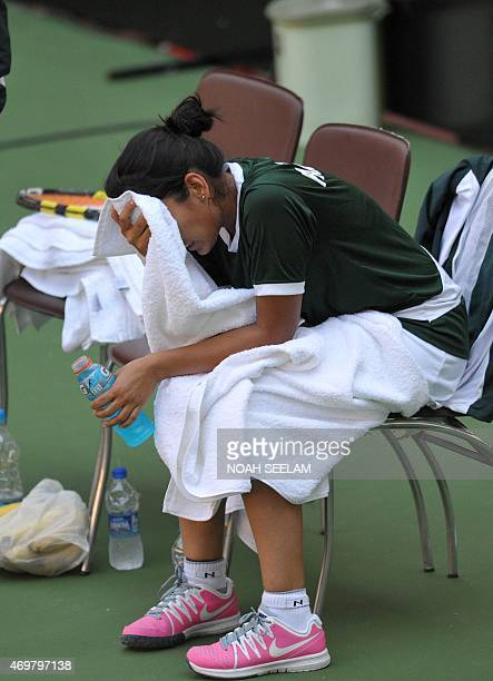 Pakistan's Sarah Mansoor reacts after losing to India's Prarthana G Thombare during the Fed Cup AsiaOceana Group II Tennis Championship at Fateh...