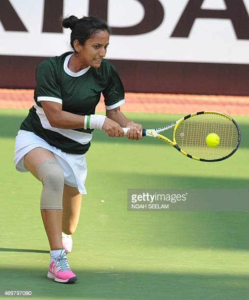 Pakistan's Sarah Mansoor returns to India's Prarthana G Thombare during the Fed Cup AsiaOceana Group II Tennis Championship at Fateh Maidan Tennis...