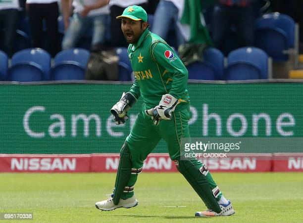 Pakistan's Sarfraz Ahmed celebrates taking the wicket of Sri Lanka's Niroshan Dickwella for 73 runs during the ICC Champions Trophy match between Sri...