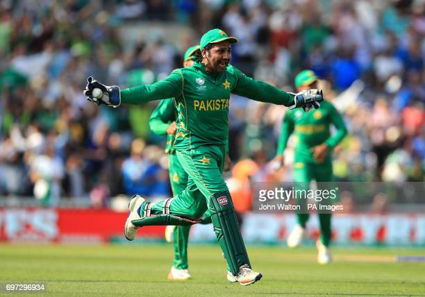 Pakistan's Sarfraz Ahmed celebrates with teammates after catching India's Jasprit Bumrah out to win the match during the ICC Champions Trophy final...