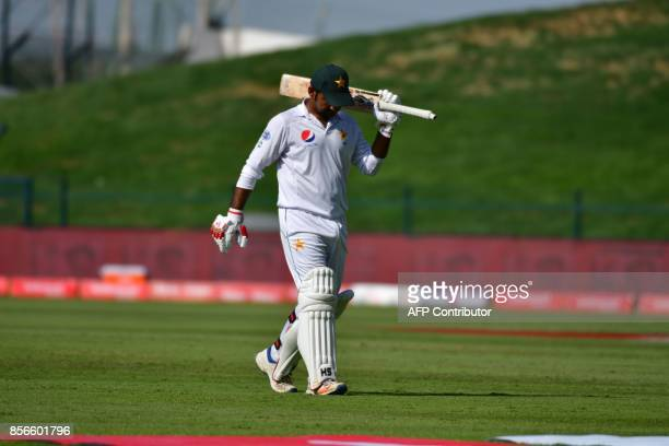 Pakistan's Sarfraz Ahmed leaves the field after his dismissal by Sri Lanka's Rangana Herath during the fifth day of the first Test cricket match...