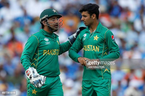 Pakistan's Sarfraz Ahmed speaks with Pakistan's Shadab Khan during the ICC Champions Trophy final cricket match between India and Pakistan at The...