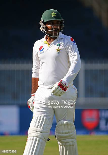 Pakistan's Sarfraz Ahmed walks from the pitch after he was dismissed during the fourth day of the third Test cricket match between Pakistan and...