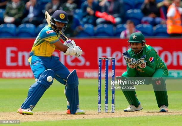 Pakistan's Sarfraz Ahmed watches as Sri Lanka's Niroshan Dickwella plays a shot during the ICC Champions Trophy match between Sri Lanka and Pakistan...