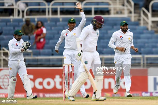 Pakistan's Sarfraz Ahmed Younis Khan and Azhar Ali celebrate the dismissal of West Indies' batsman Devendra Bishoo on day two of the first Test match...