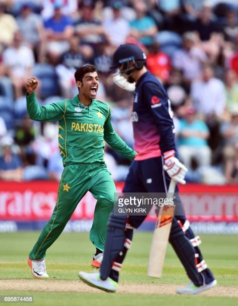Pakistan's Shadab Khan celebrates after taking the wicket of England's Joe Root for 46 runs during the ICC Champions Trophy semifinal cricket match...