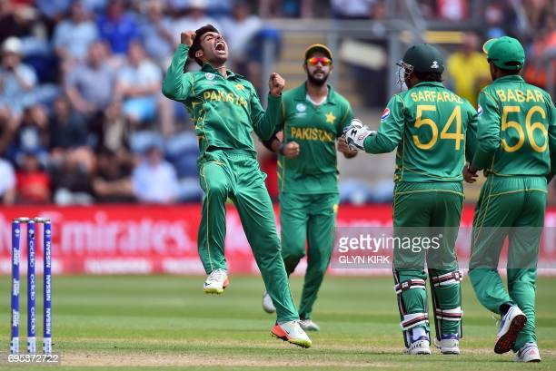 Pakistan's Shadab Khan celebrates with team mates after taking the wicket of England's Joe Root for 46 runs during the ICC Champions Trophy semifinal...