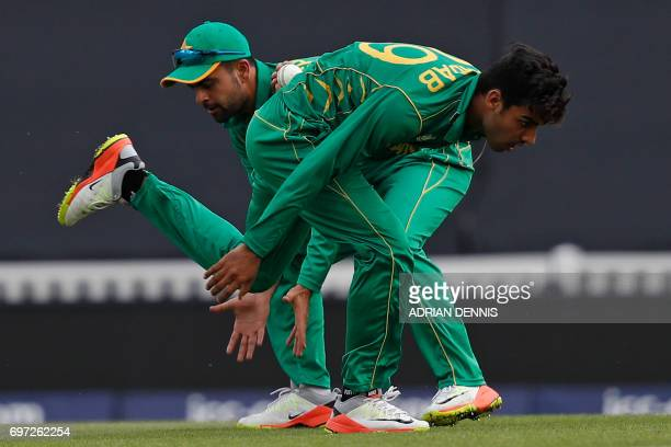 Pakistan's Shadab Khan gathers the ball during the ICC Champions Trophy final cricket match between India and Pakistan at The Oval in London on June...