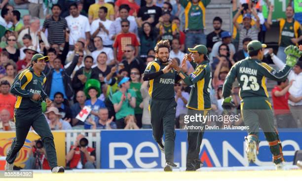 Pakistan's Shahid Afridi celebrates after catching New Zealand's Scott Styris off the bowling of Umar Gul during the ICC World Twenty20 Super Eights...