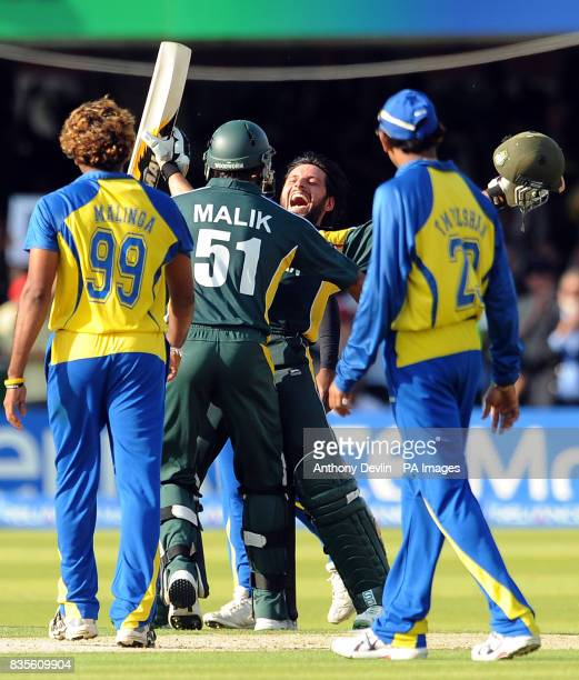 Pakistan's Shahid Afridi celebrates hitting the winning runs with Shoaib Malik during the Final of the ICC World Twenty20 at Lords London