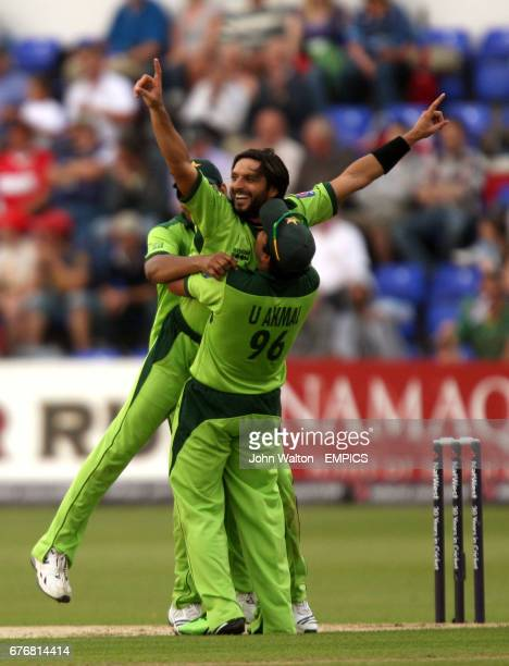 Pakistan's Shahid Afridi is congratulated after dismissing England's Luke Wright for 0
