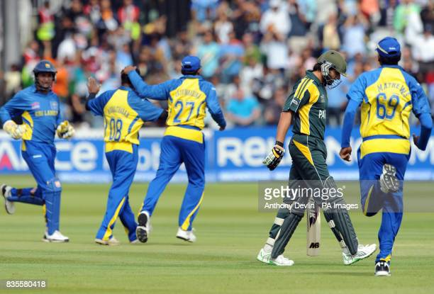 Pakistan's Shahid Afridi leaves the field dejected after he is out first ball caught by Tillakaratne Dilshan off the bowling of Muttiah Muralitharan...