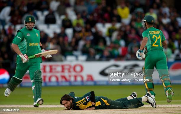 Pakistan's Shahid Afridi lies on the ground as South Africa's Jacques Kallis and JeanPaul Duminy score runs during the ICC World Twenty20 Semi Final...