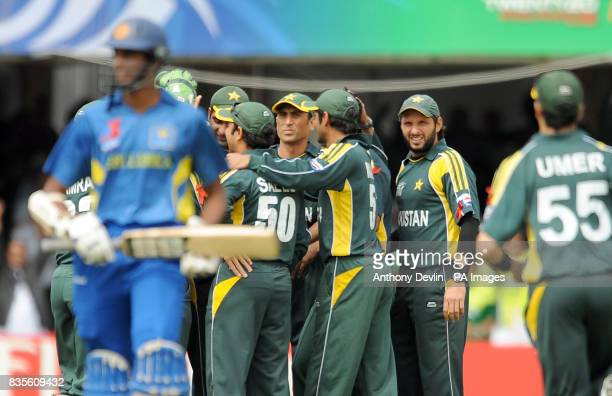 Pakistan's Shahid Afridi looks on as Jehan Mubarak leaves the field after being caught by Ahmed Shahzaib during the Final of the ICC World Twenty20...
