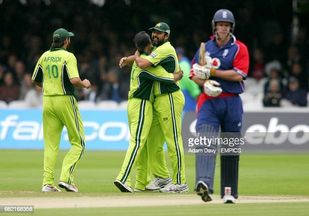 Pakistan's Shahid Afridi Shoaib Akhtar and InzamamulHaq celebrate the wicket of England's Andrew Strauss