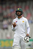 Pakistan's Shan Masood leaves the pitch after being dismissed by England's James Anderson on the third day of the second Test cricket match between...