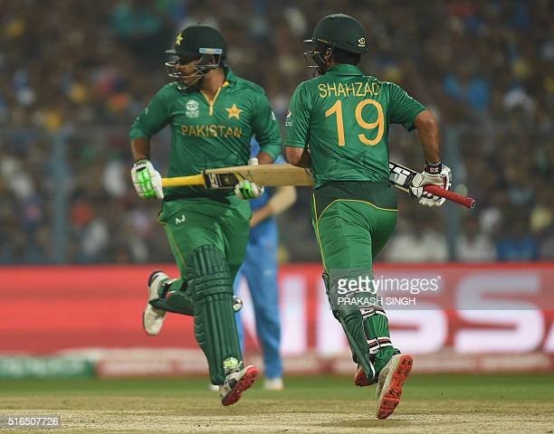 Pakistan's Sharjeel Khan and Ahmed Shehzad run between the wickets during the World T20 cricket tournament match between India and Pakistan at the...