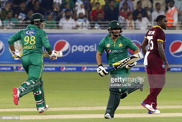 Pakistan's Sharjeel Khan and Khalid Latif run betwen the wickets during the first T20I match between Pakistan and the West Indies at the Dubai...